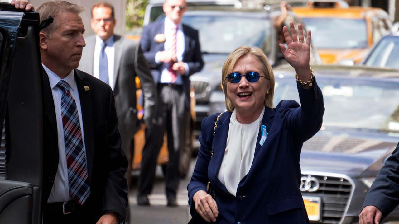 Democratic presidential candidate Hillary Clinton waves as she walks from an apartment building Sunday, Sept. 11, 2016, in New York.