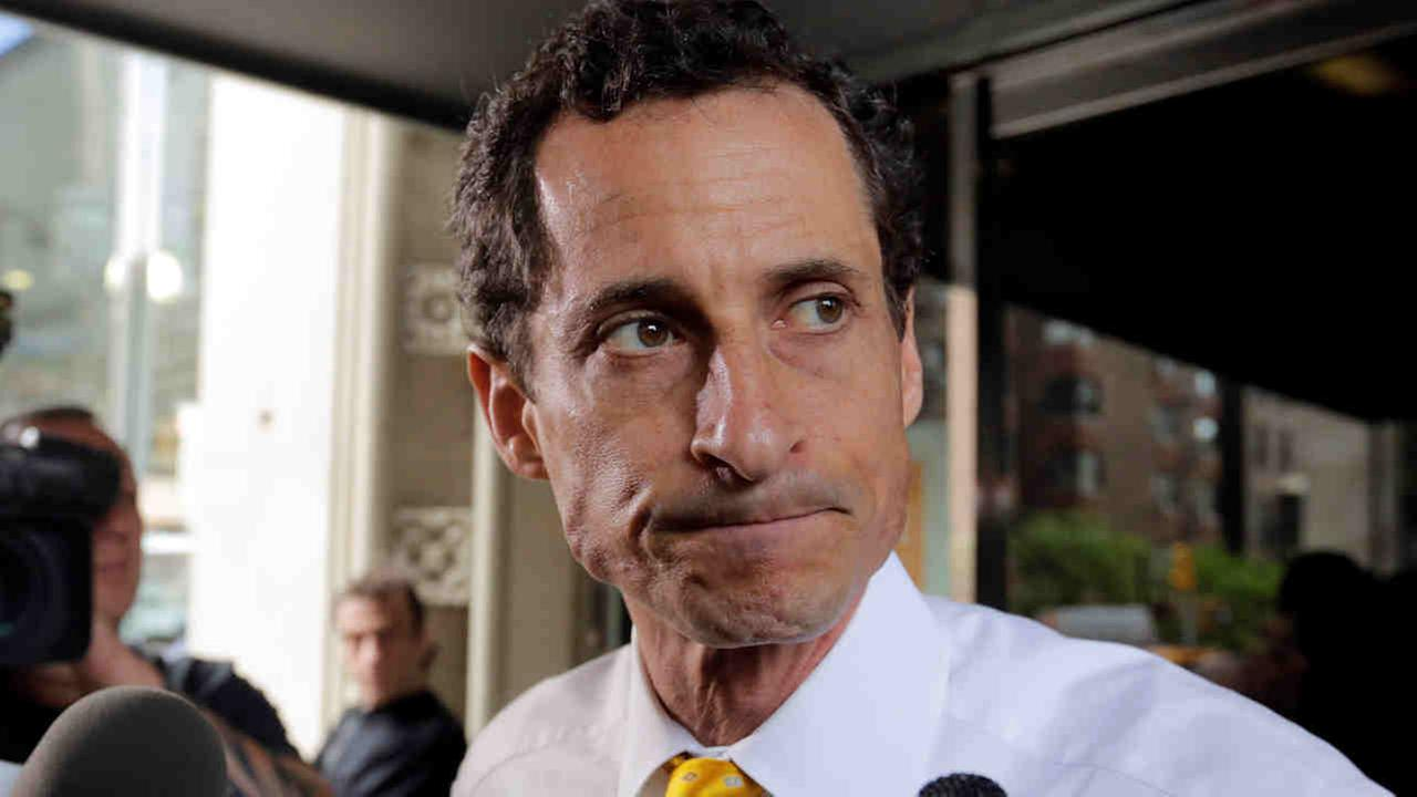 In this July 24, 2013 file photo, Anthony Weiner leaves his apartment building in New York.