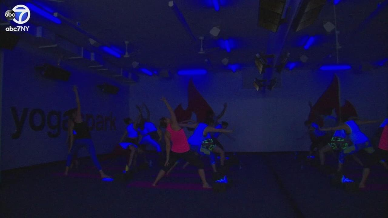 030717-wabc-black-light-yoga-vid