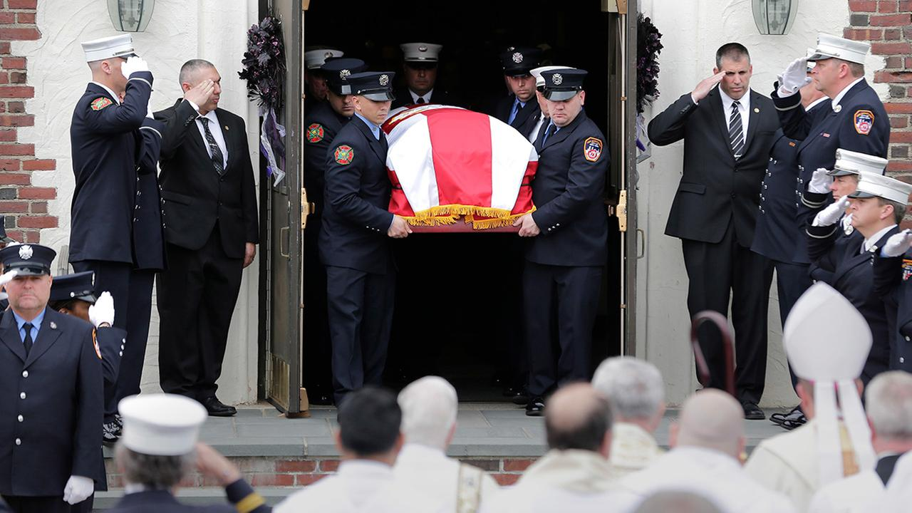 William Tolleys casket is carried out of a church during his funeral in Bethpage, N.Y., Thursday, April 27, 2017.
