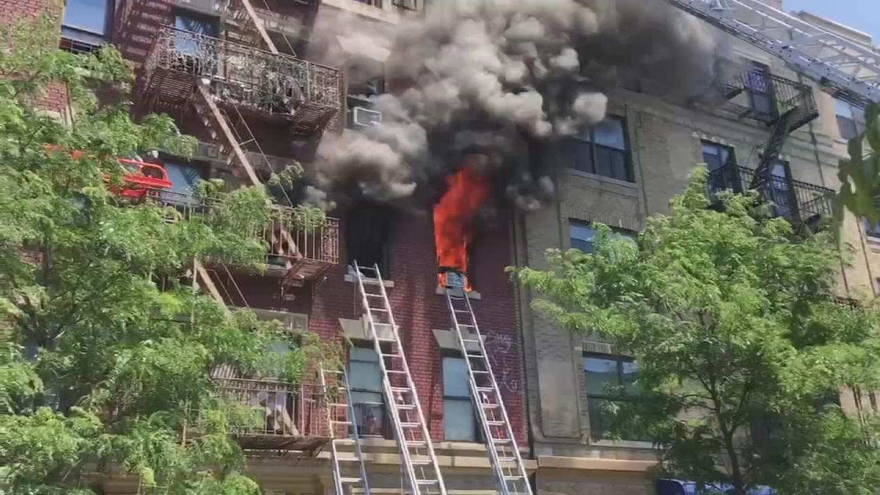 Raw: Flames shoot from windows of Bronx apartment