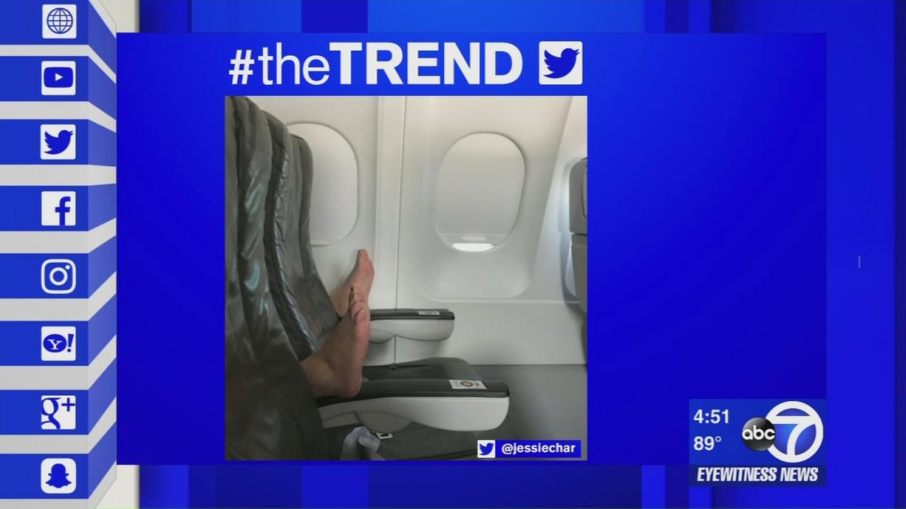 The Trend: Airline passenger plants bare feet on arm rests during flight