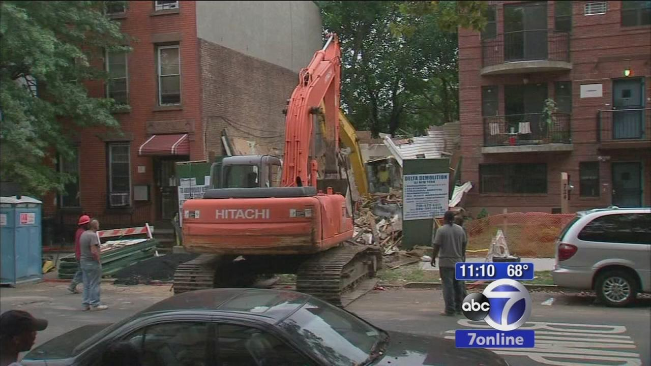 Family startled by excavator crashing into wall