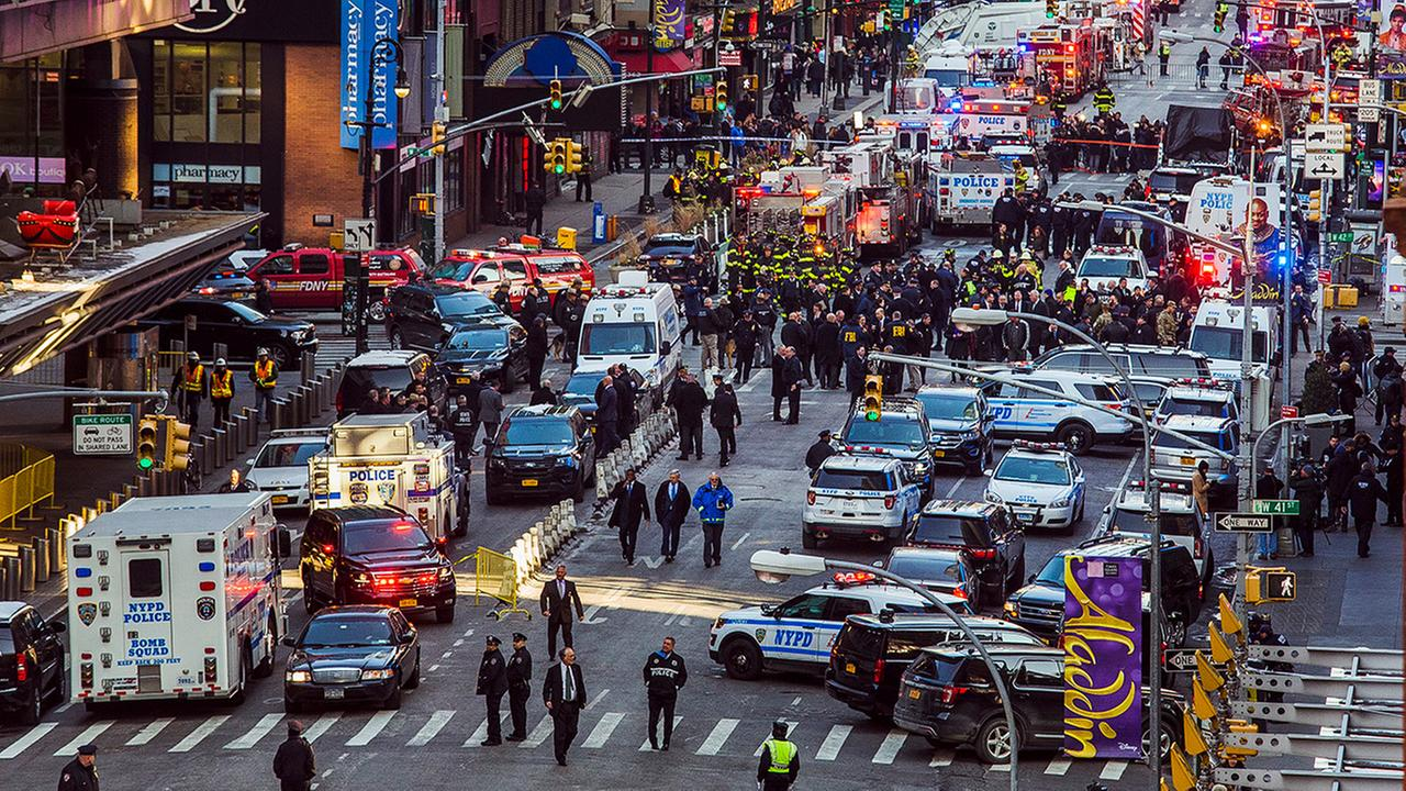 Law enforcement officials work following an explosion near New Yorks Times Square on Monday, Dec. 11, 2017.