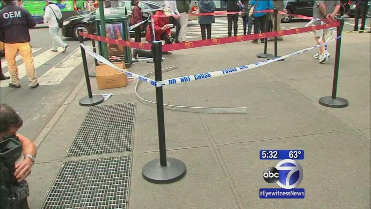 2 people hit by fallng debris from Midtown building