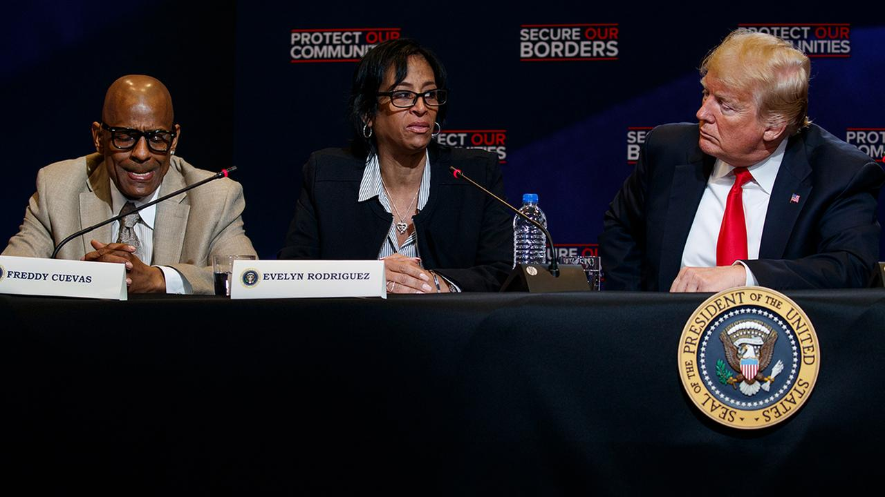 Freddy Cuevas, left, and President Donald Trump listen as Evelyn Rodriguez speaks about the murder of her daughter by the MS-13 street gang. (AP Photo/Evan Vucci)