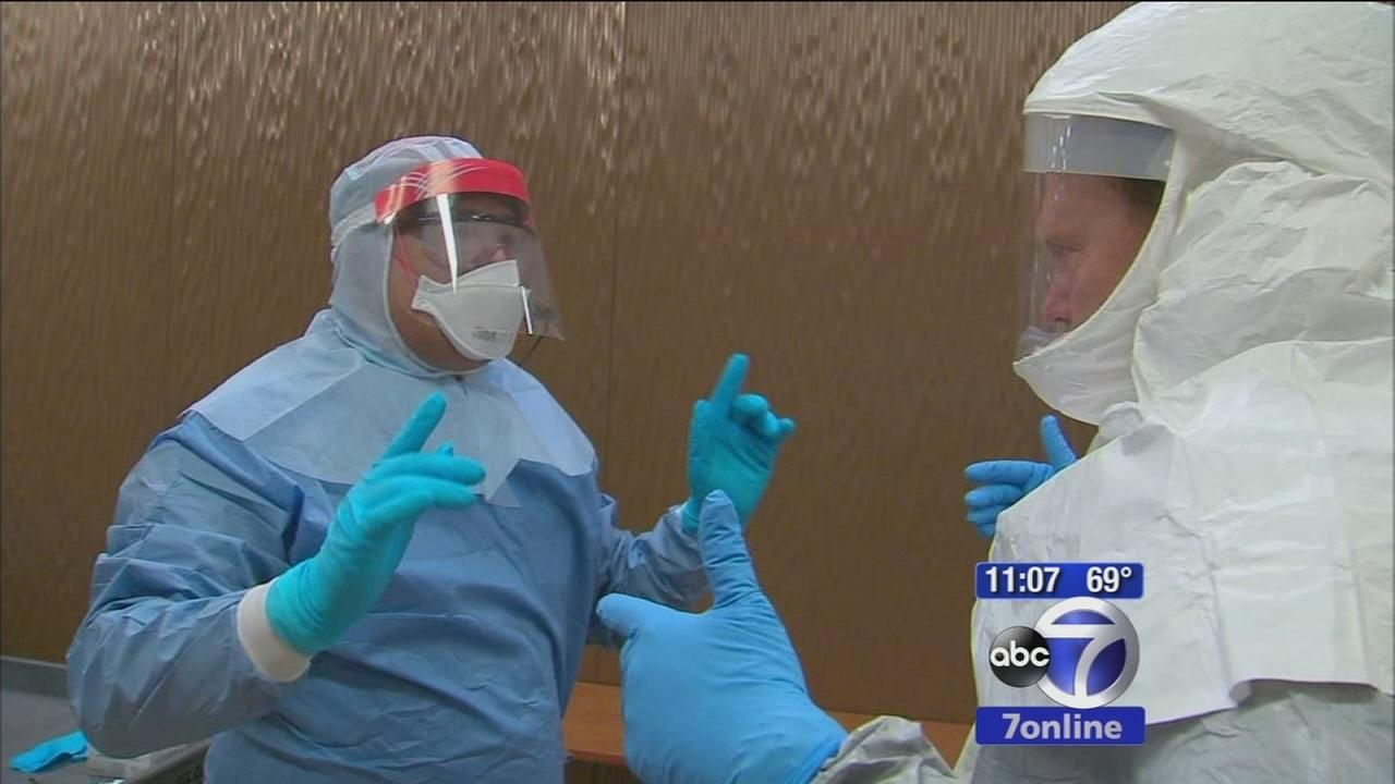 Inside look at how healthcare workers protect themselves while treating Ebola patients