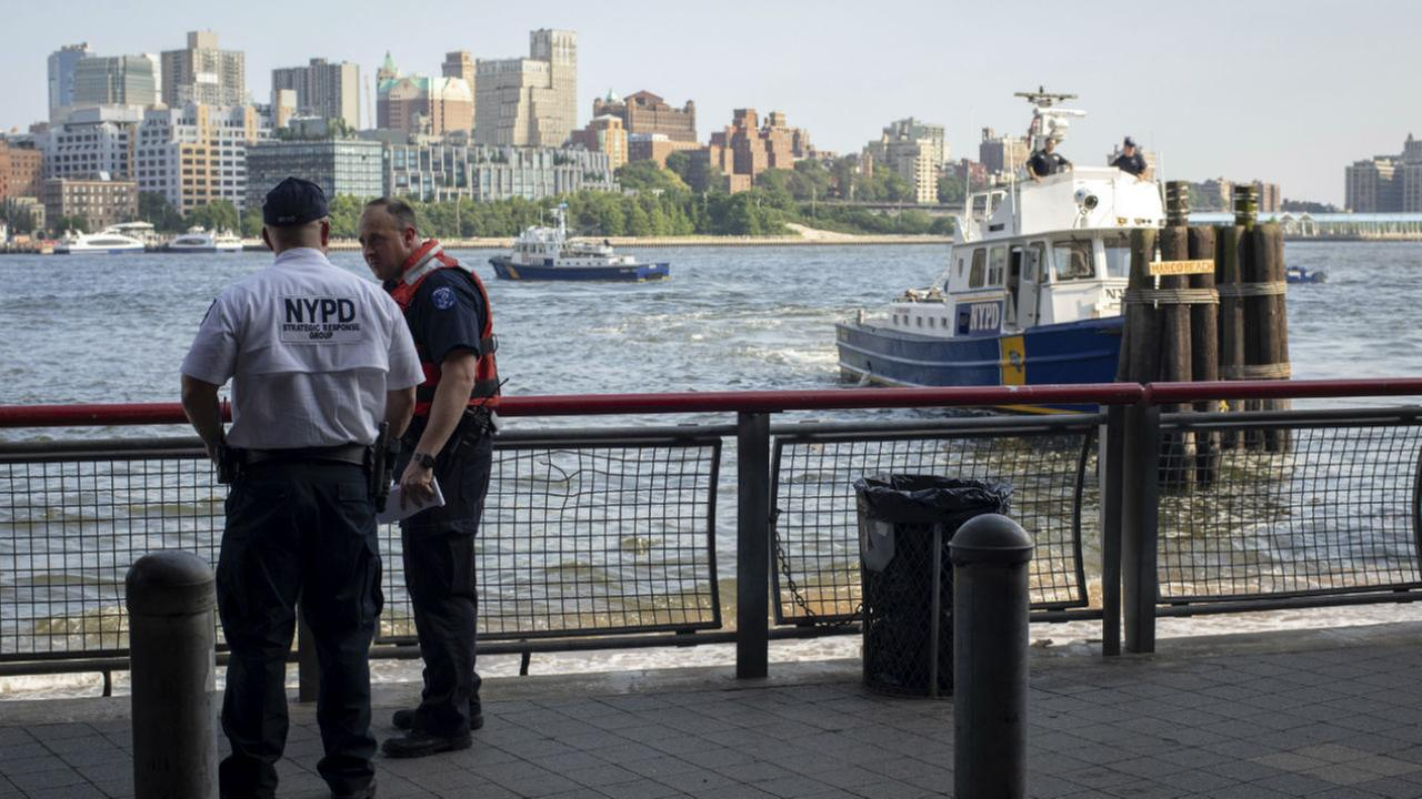 In this Aug. 5, 2018, file photo, authorities investigate the death of a baby boy who was found floating in the East River near the Brooklyn Bridge.