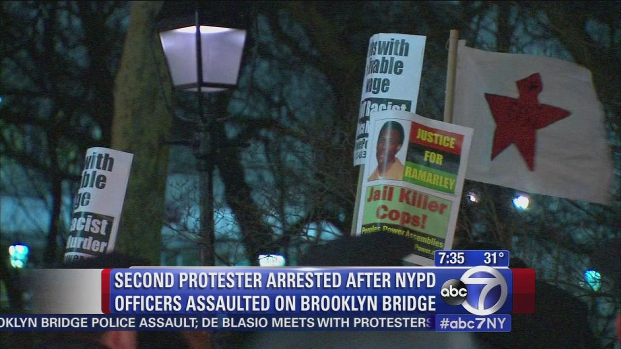 Polcie arrest 2 wanted protesters