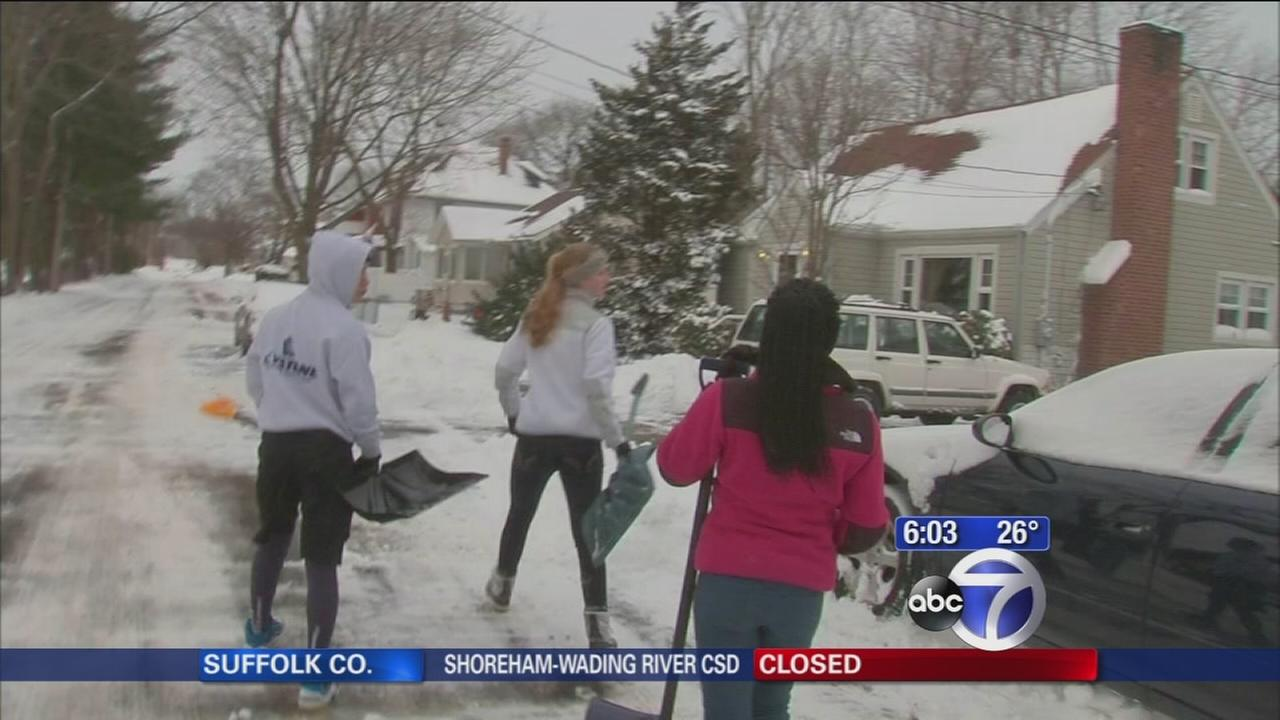 Neighbors helping neighbors dig out of snow in Connecticut