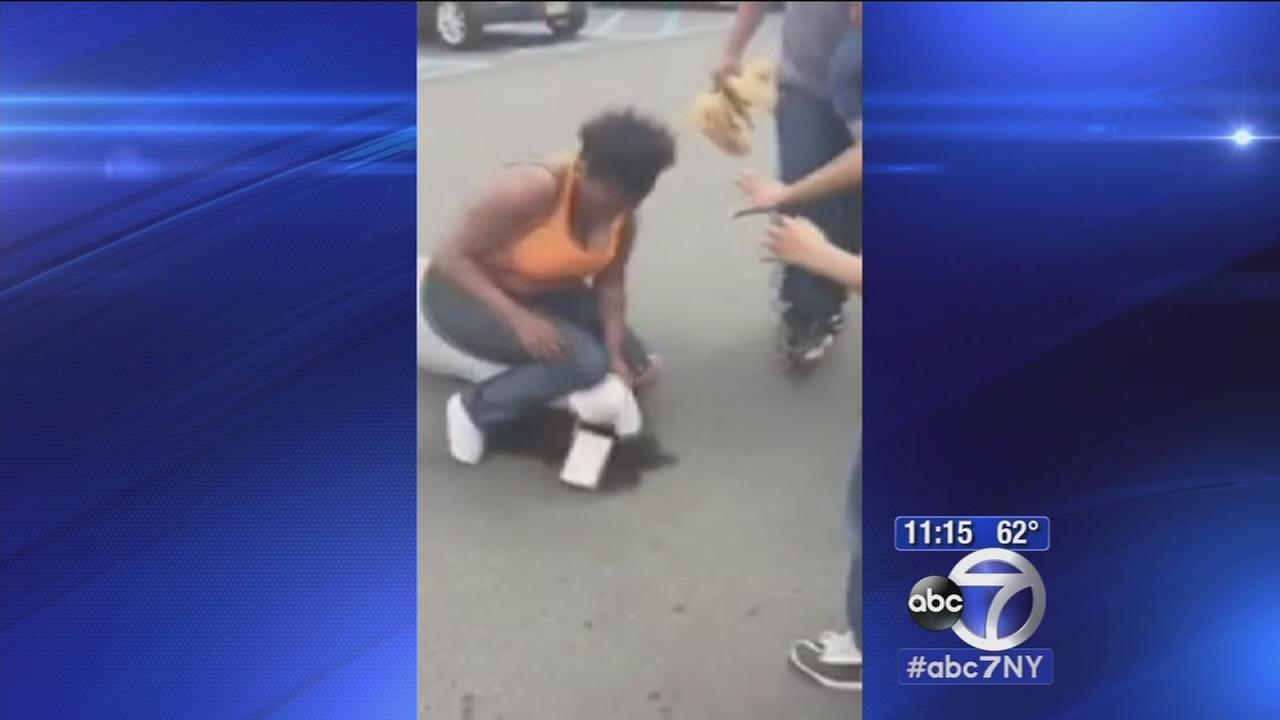 2 women in caught-on-camera LI parking lot brawl arrested