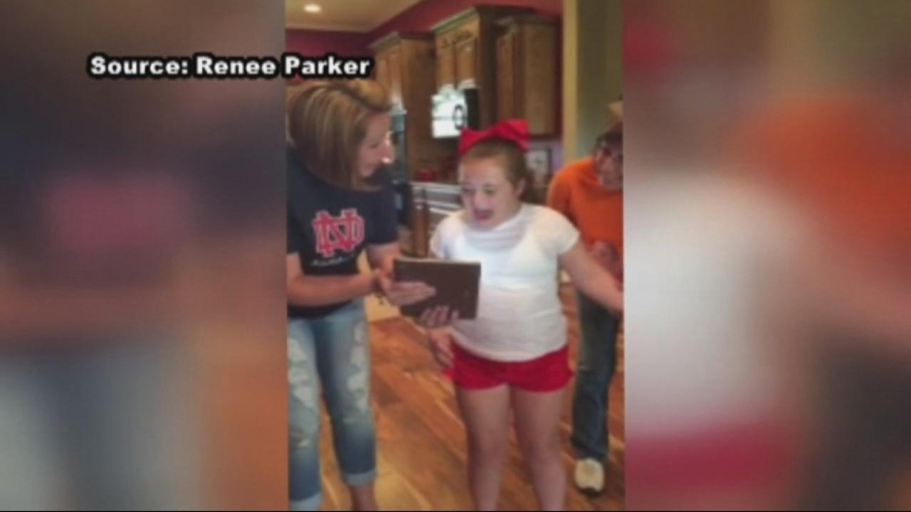 Girl with Down syndrome learns she made cheerleading squad