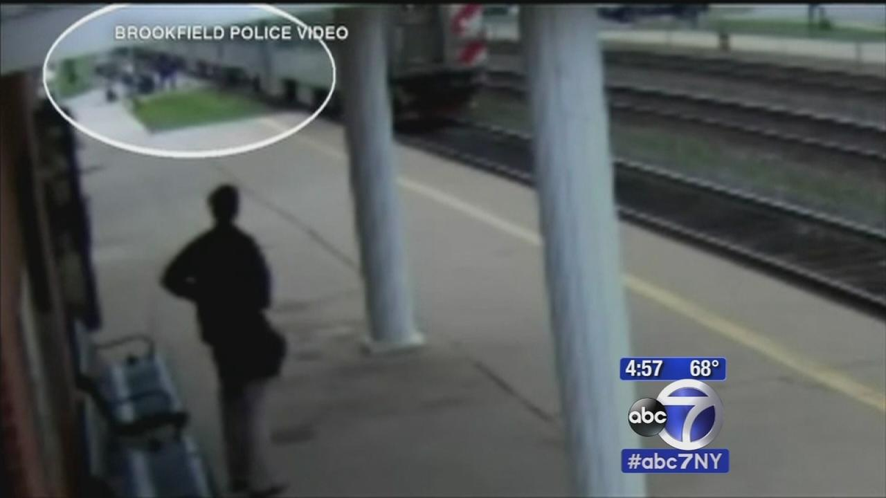 Woman falls out of wheelchair onto tracks, rescued by Good Samaritan