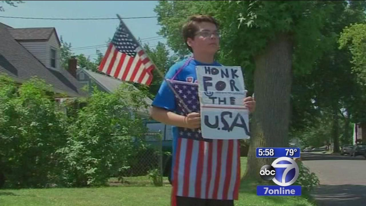Rahway teen stands post on street corner holding American flag and asking for honks