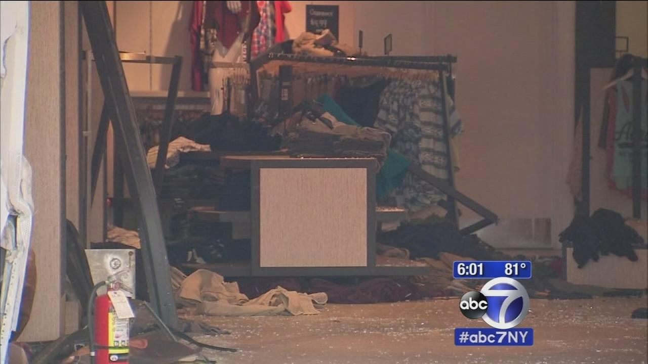 Car crashes into Queens clothing store
