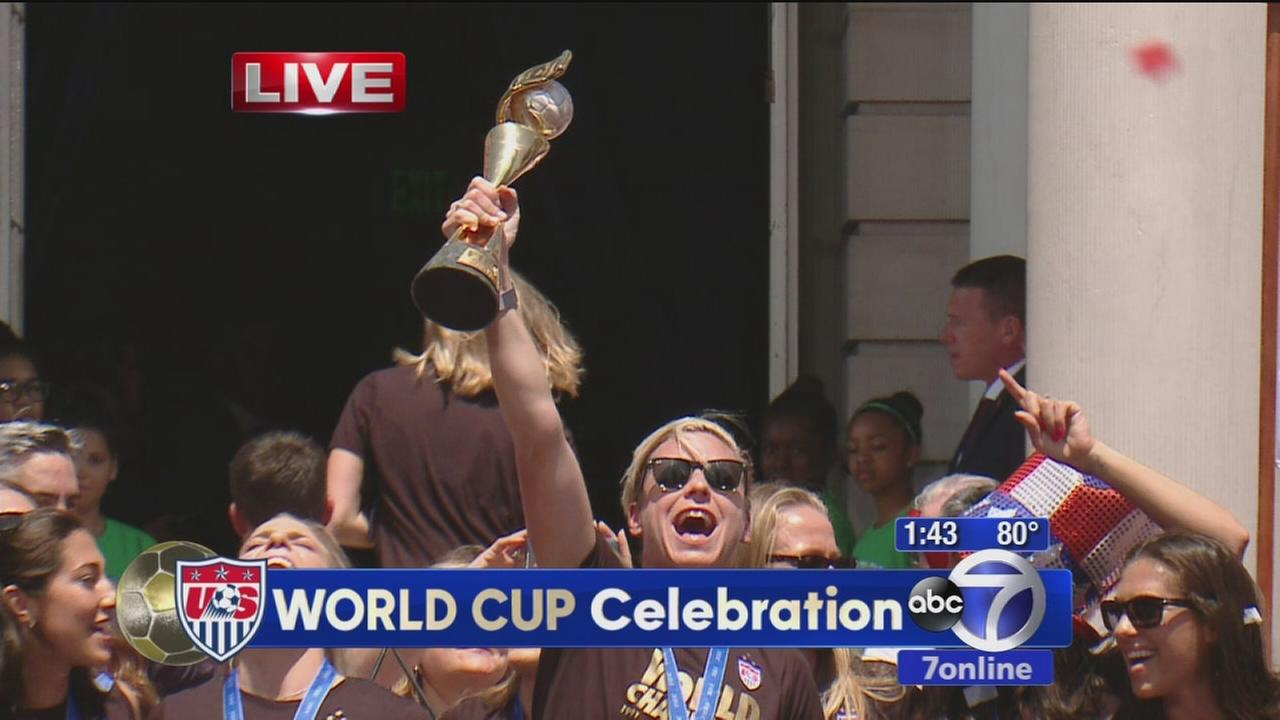 US Womens National Team celebrates with World Cup trophy