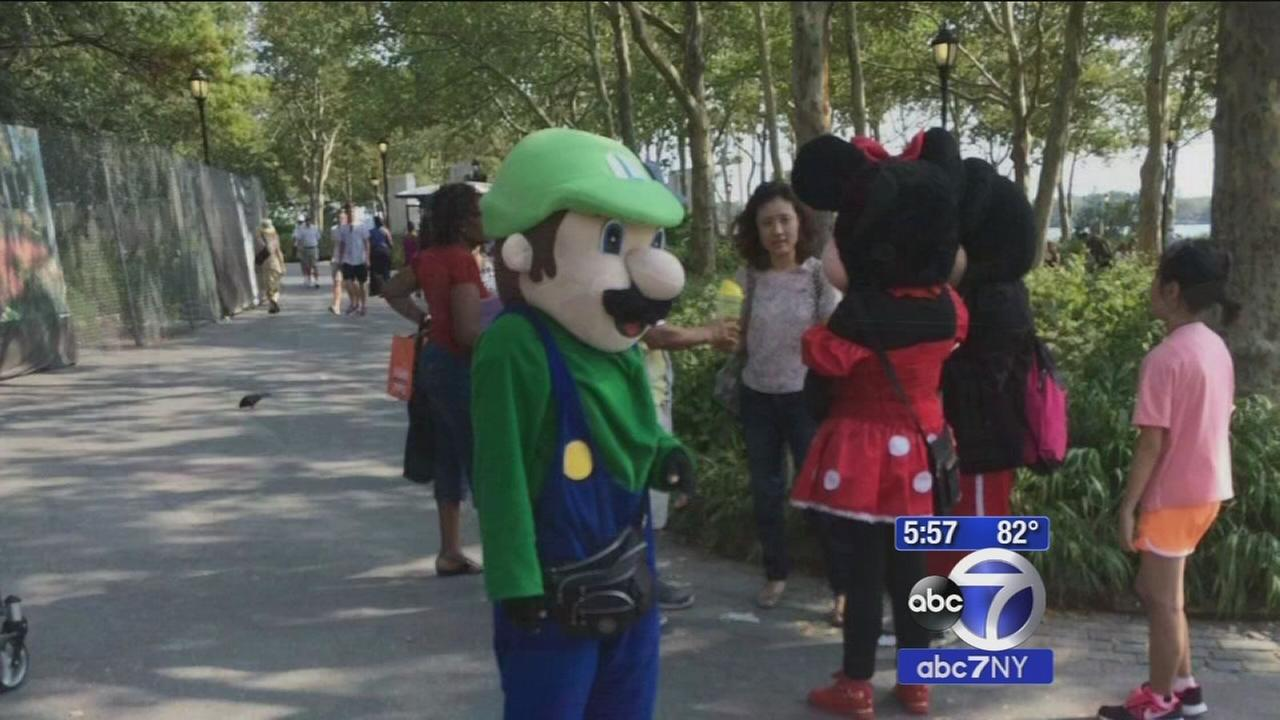 Costumed characters crack down at Battery Park
