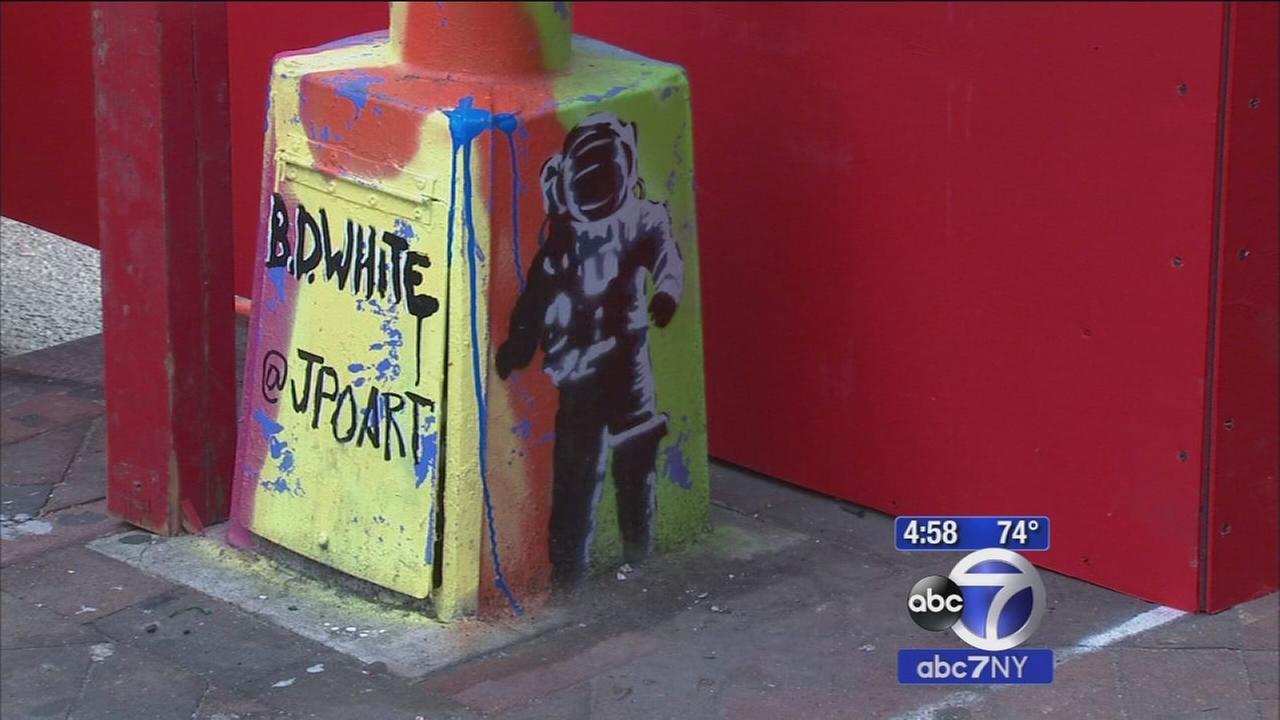 Artists paint lampposts in Little Italy to share artwork