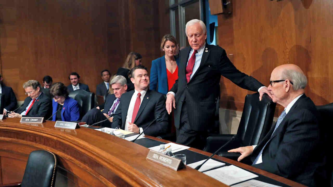 Senate Health, Education, Labor, and Pensions Committee member Sen. Orrin Hatch, R-Utah, center, takes his seat on Capitol Hill in Tuesday.