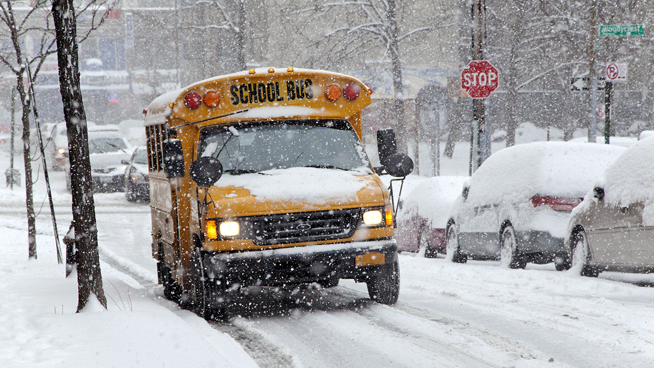 STOCK IMAGE: A school bus sits in the snow in the Bronx