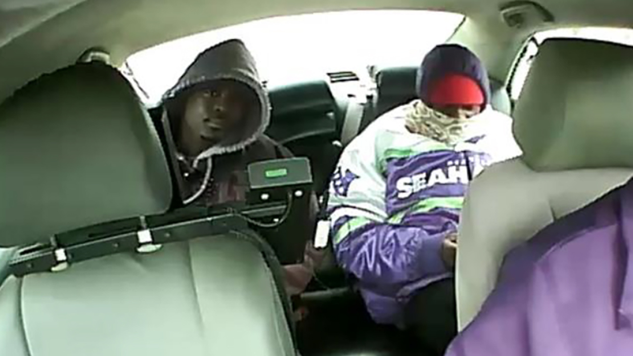 A surveillance image of two people Chicago police are seeking to identify in connection to a robbery of a taxi driver.