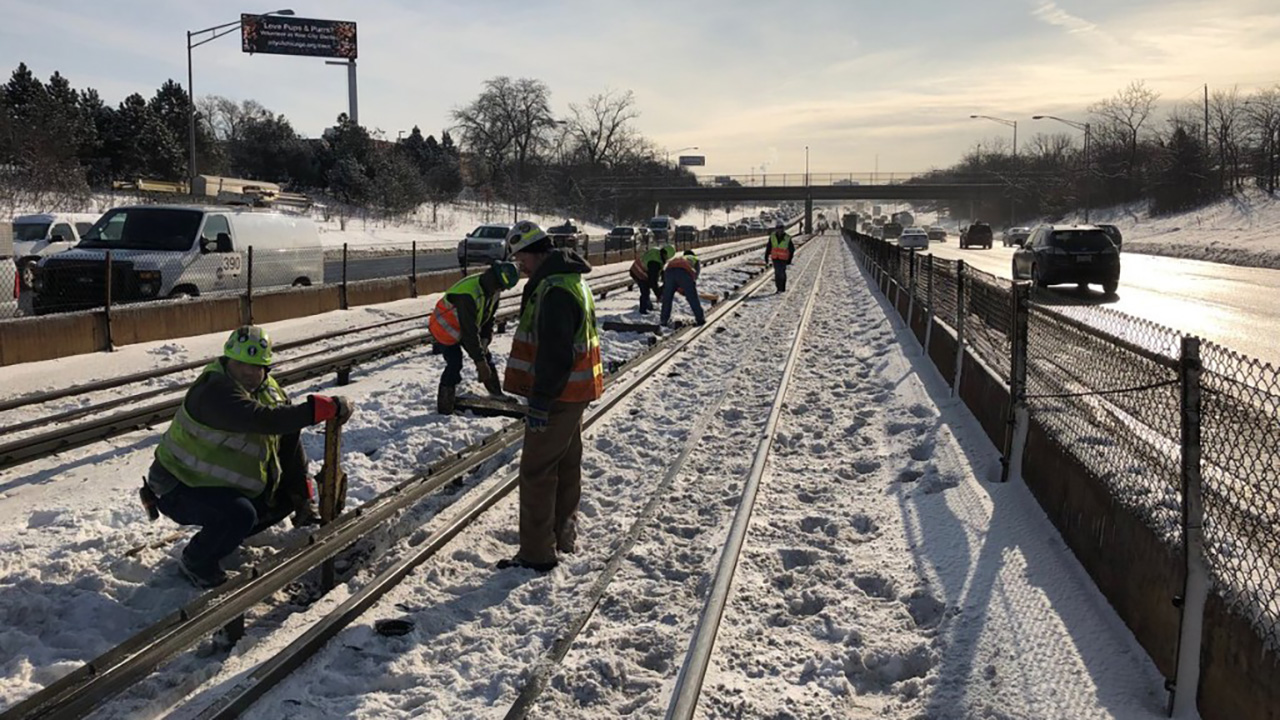 Chicago Transit Authority crews work to repair a rail malfunction that caused major delays on the Blue Line near the Forest Park station on Friday, Feb. 1, 2019.