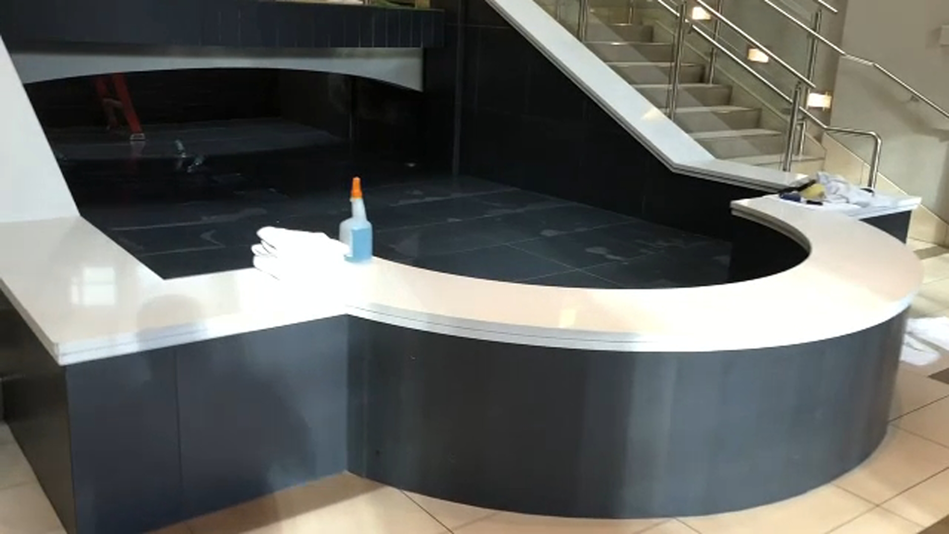A closed water feature inside the Embassy Suites hotel.