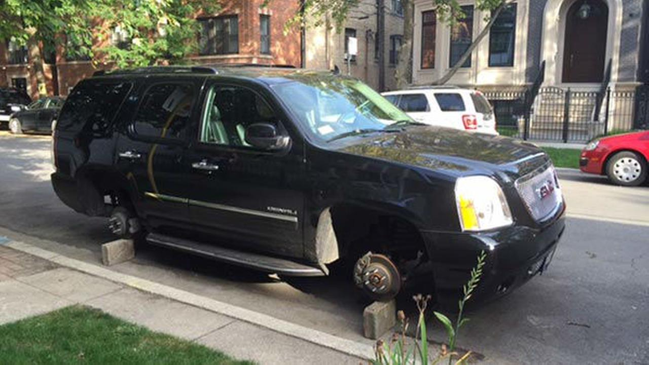 PHOTOS: Car ticketed for street cleaning after tires stolen