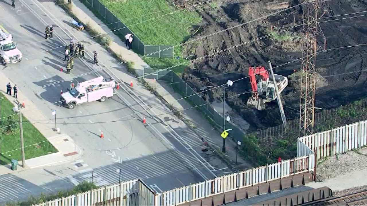 Man trapped in crane that hit power lines in West Side
