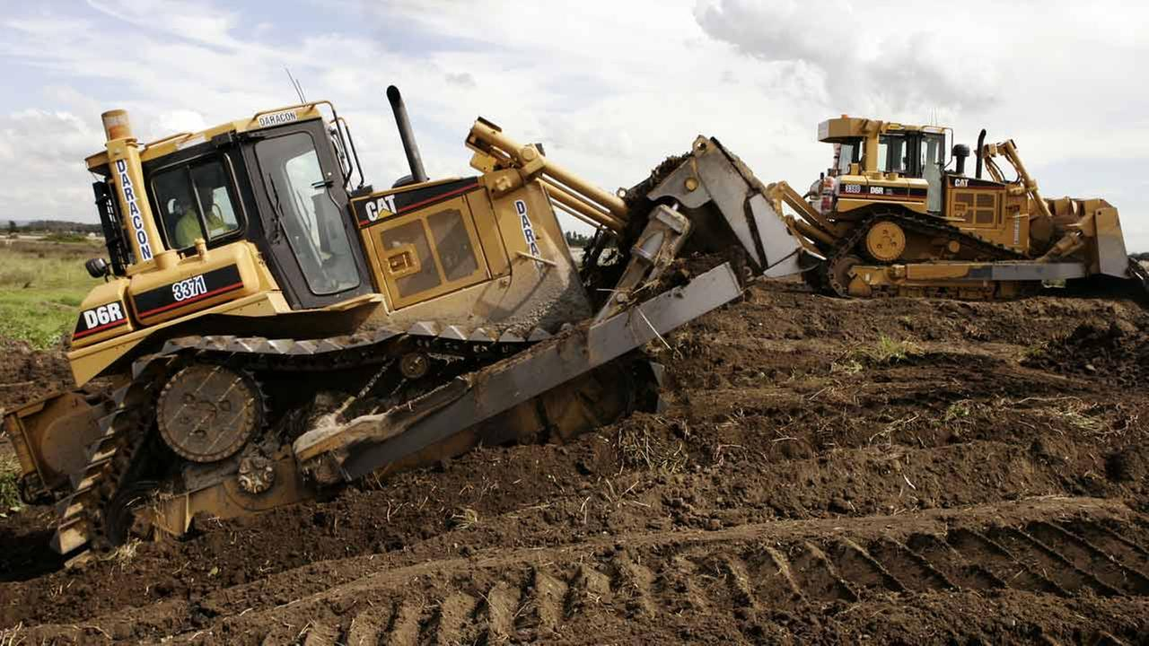 (FILE) A pair of Caterpillar D6 bulldozers work on construction.