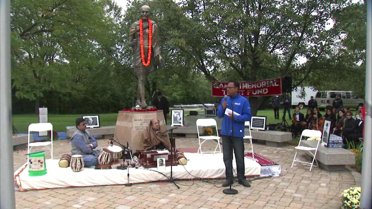 The broader Skokie-Evanston community joined hands Sunday afternoon at the statue to Mahatma Gandhi on McCormick Boulevard.