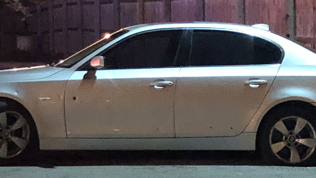A car was riddled with bullets in the northbound lanes of I-57 in Calumet Park Friday morning.