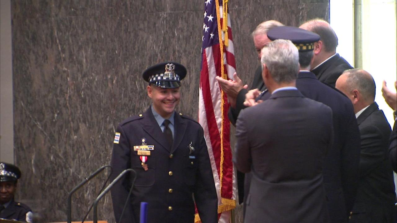The city honored police Officer Jorge Flores with the Carter Harrison Award. Flores stopped an armed robbery while off-duty and traveling with his family.