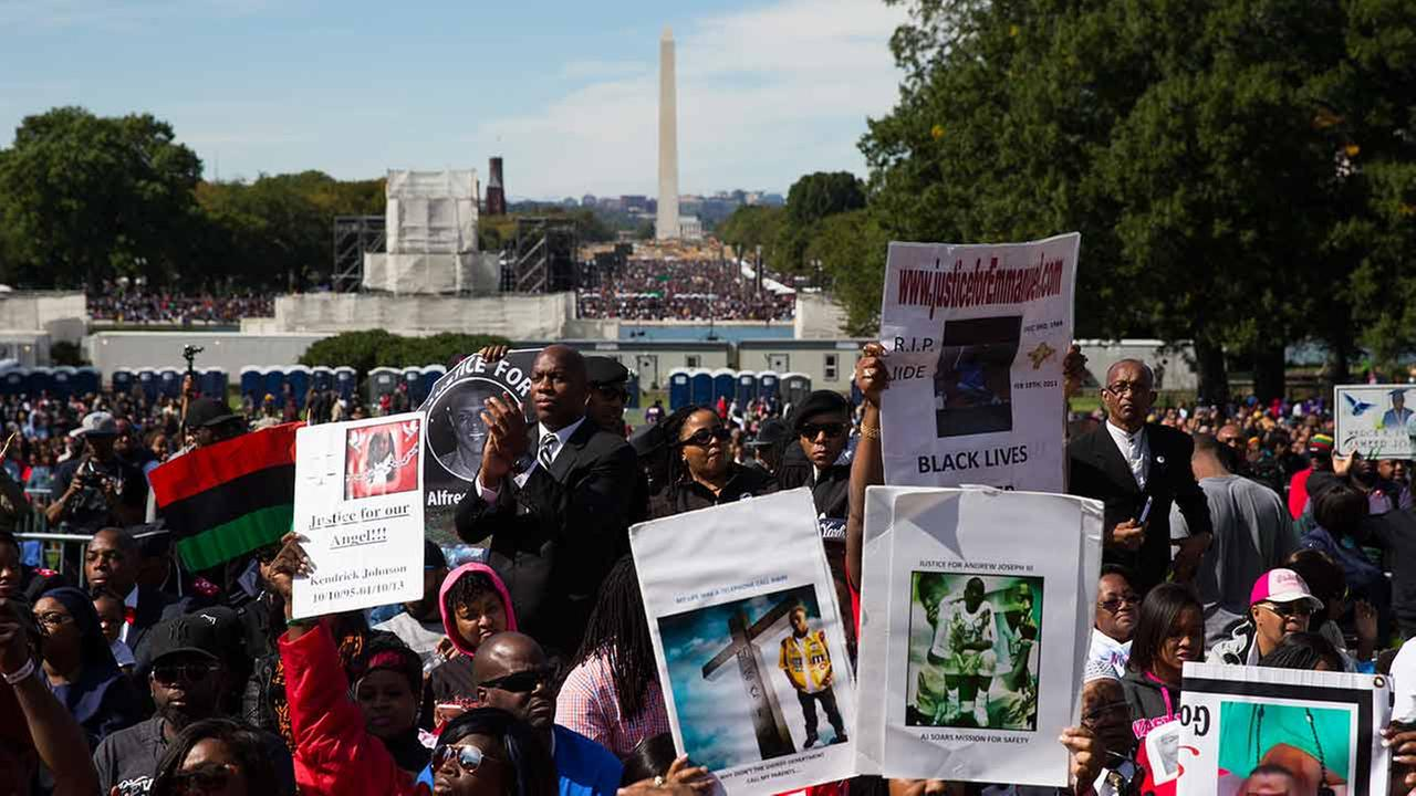 People cheer during a rally to mark the 20th anniversary of the Million Man March, on Capitol Hill, on Oct. 10, 2015, in Washington, D.C.