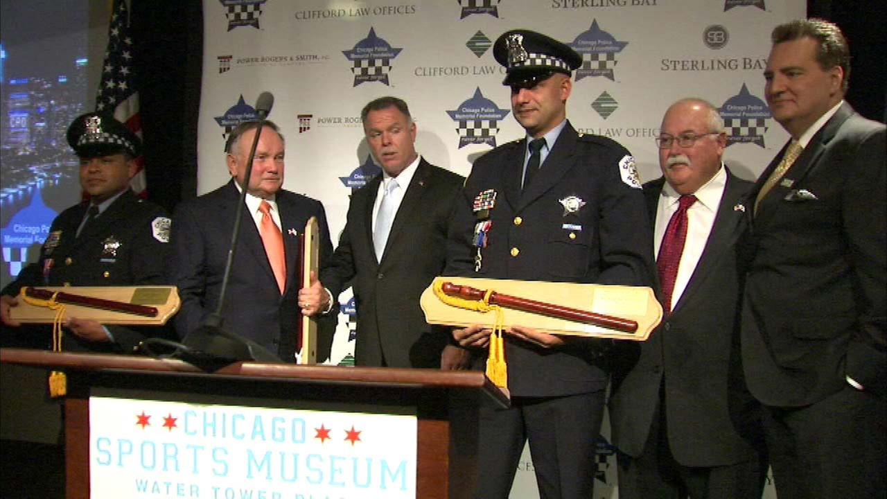 2 officers honored after injuries in 2014 shooting