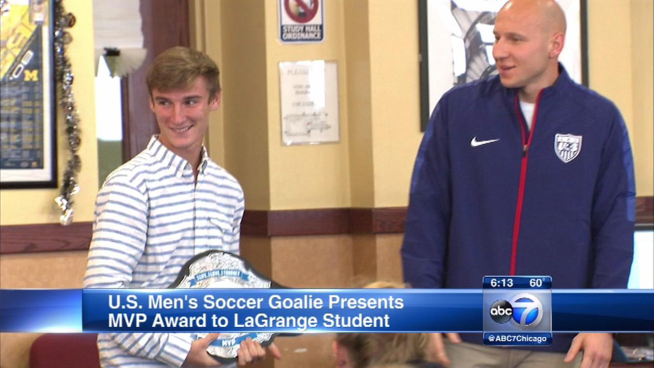 U.S. National mens soccer goalie Brad Guzan presented Lyons Township High School student Nick Economou with the MVP trophy in the annual PepsiCo Showdown.