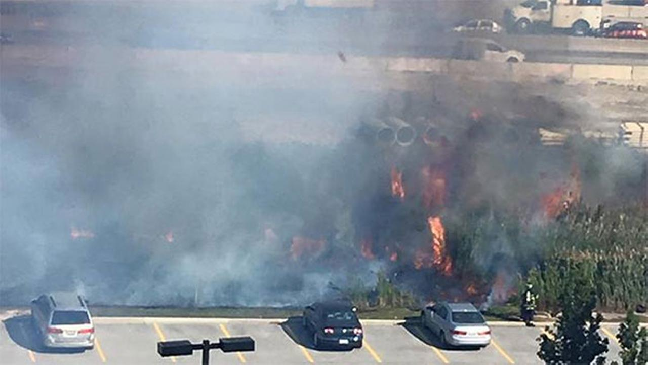 A brush fire in Schaumburg, Ill., at I-90 near Route 53 on Oct. 19, 2015.