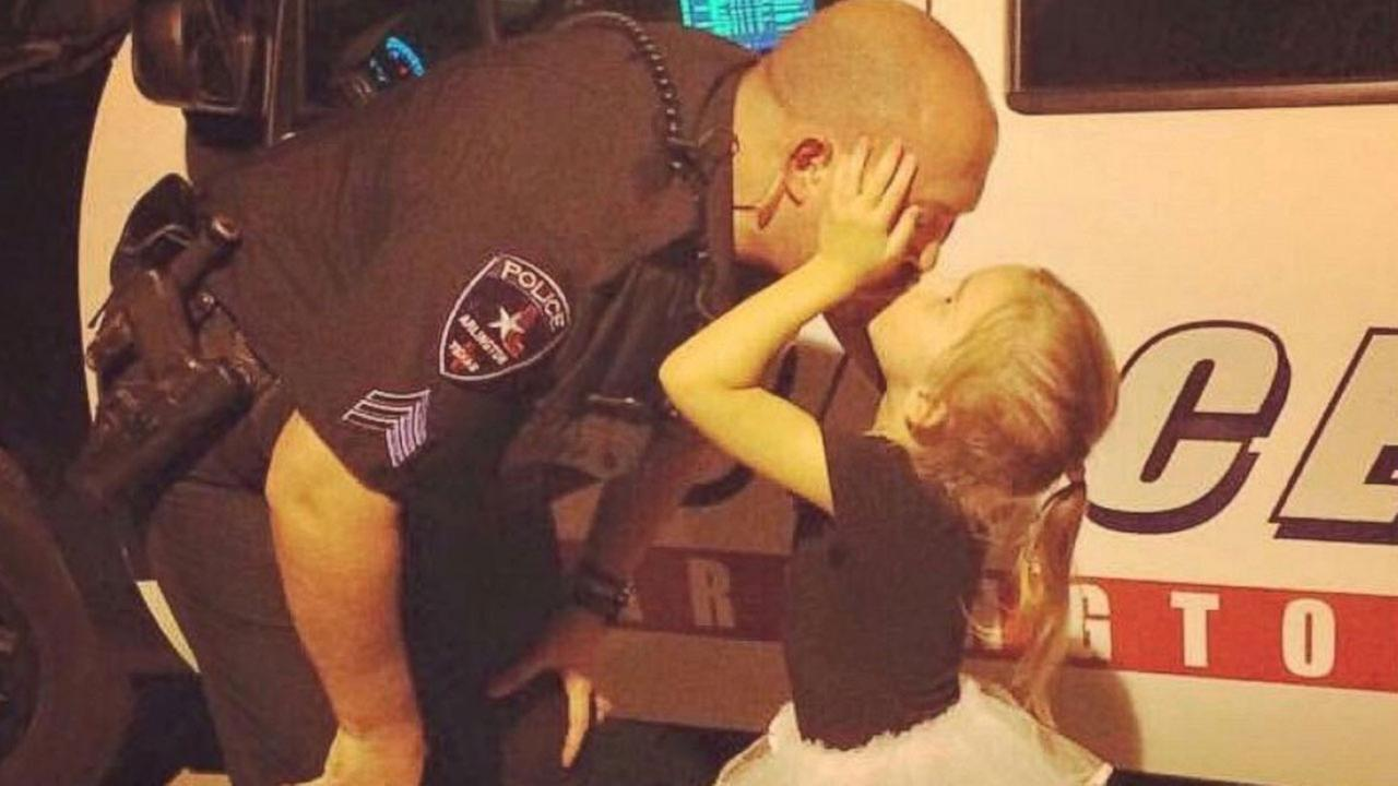 A photo of Sergeant J. McRay kissing his little girl has gone viral online.