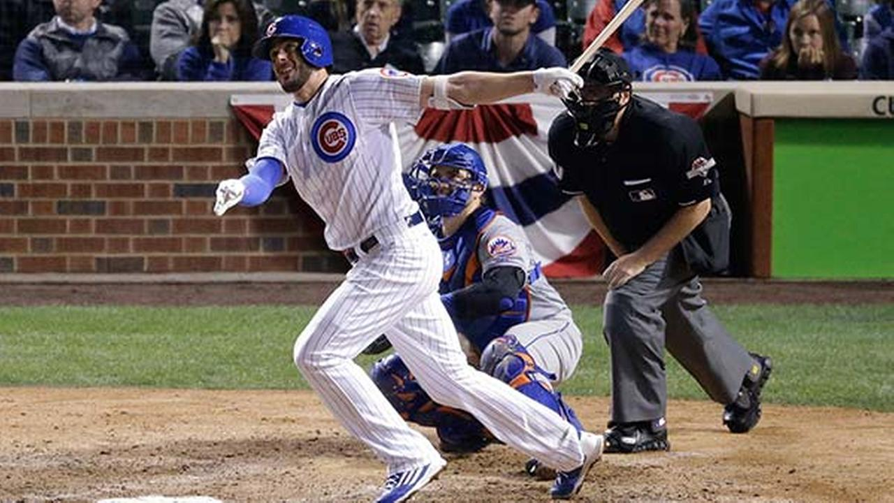 Chicago Cubs Kris Bryant hits a two-run home run during the eighth inning of Game 4 of the National League baseball championship series against the New York Mets in Chicago.