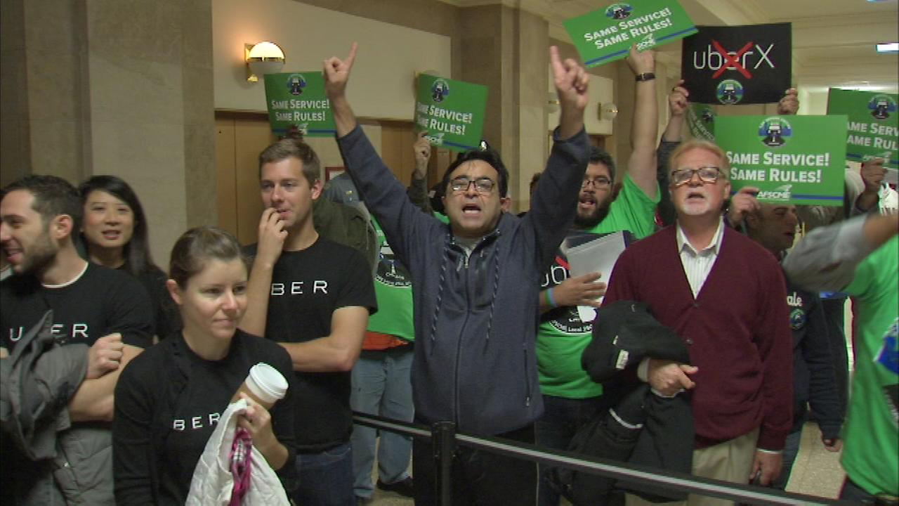 Taxi, Uber drivers have shouting match before City Council meeting