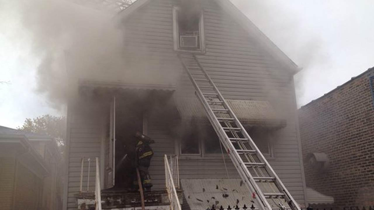 Smoke rises out of a Brighton Park home on October 27, 2015. Two people were injured, one critically.