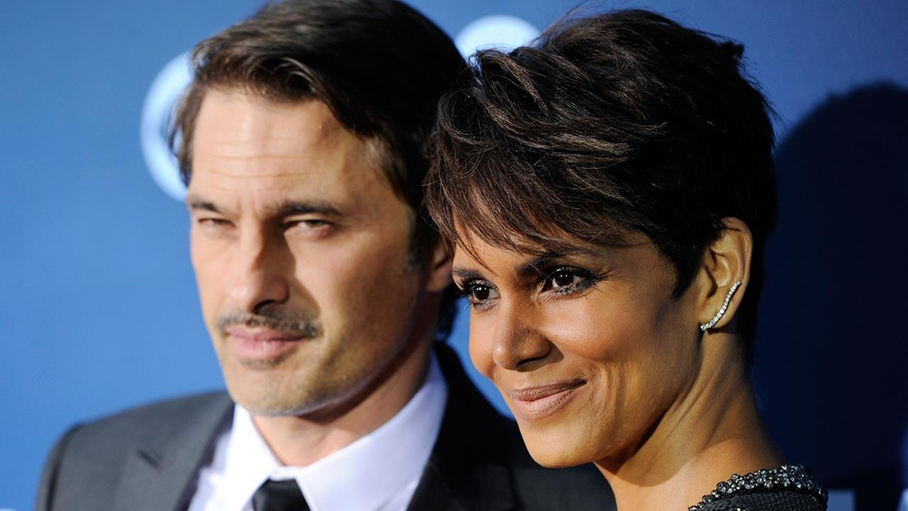 Halle Berry, a cast member in the television series Extant, poses with her husband Olivier Martinez at the premiere of the series on Monday, June 16, 2014 in Los Angeles.