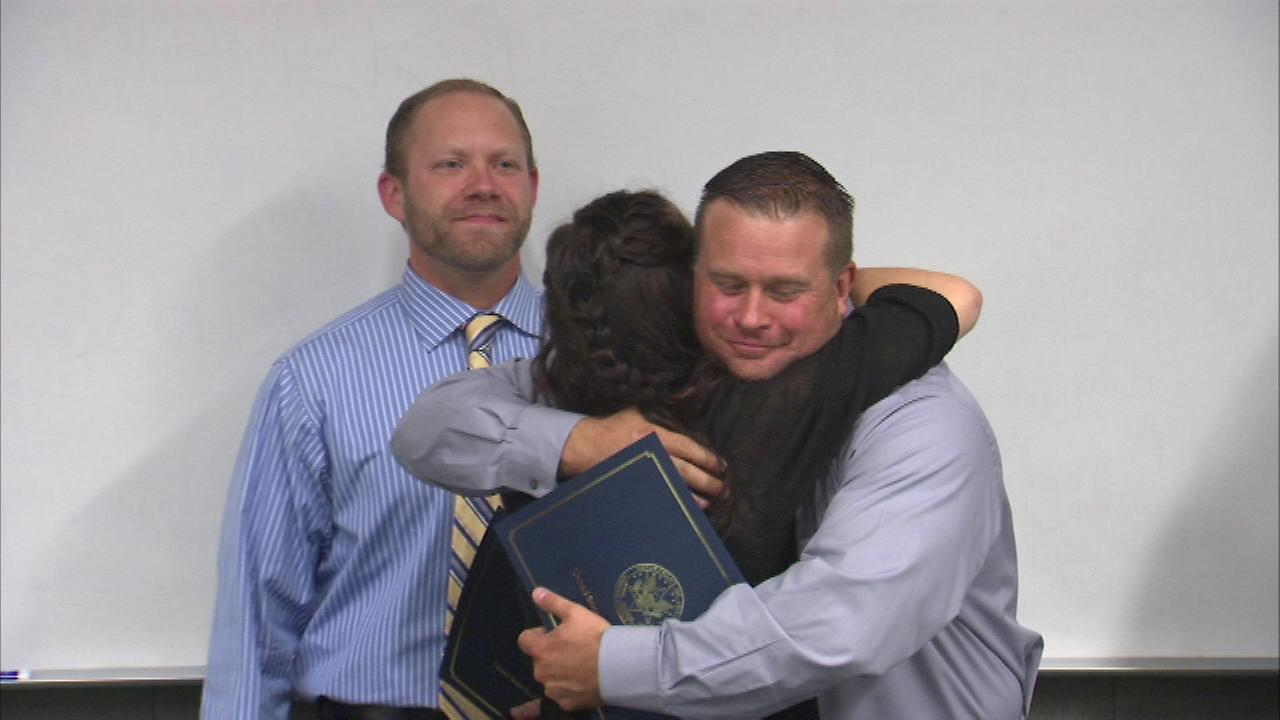 Police officers who saved a teenage girl from drowning in Aurora were honored Wednesday.