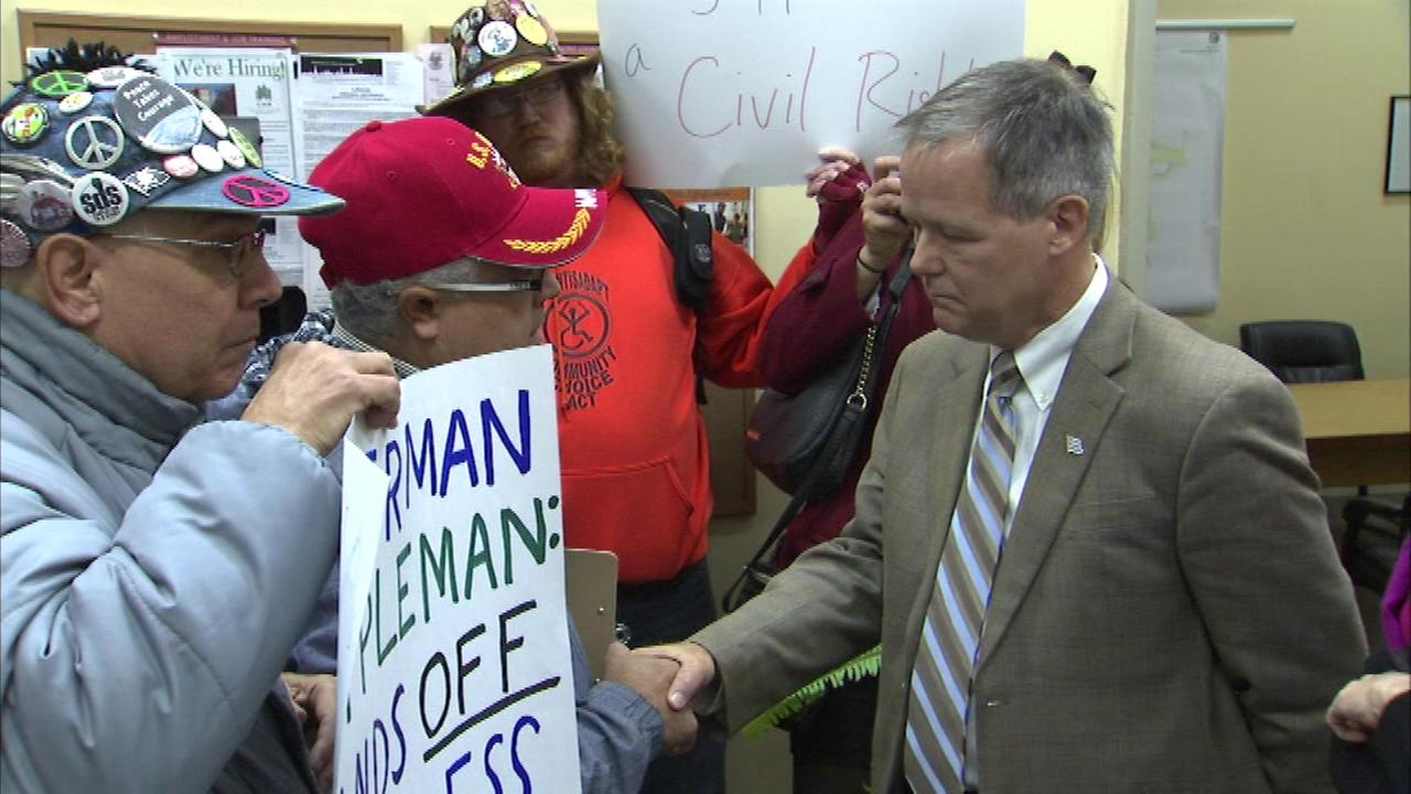 A group of protesters cornered Alderman James Cappleman at his office Monday.