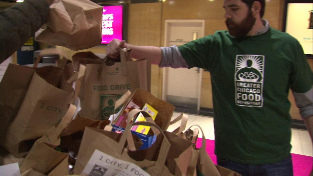 Commuters brought grocery bags filled with non-perishable foods as part of the Greater Chicago Food Depositorys One City, One Food Drive.