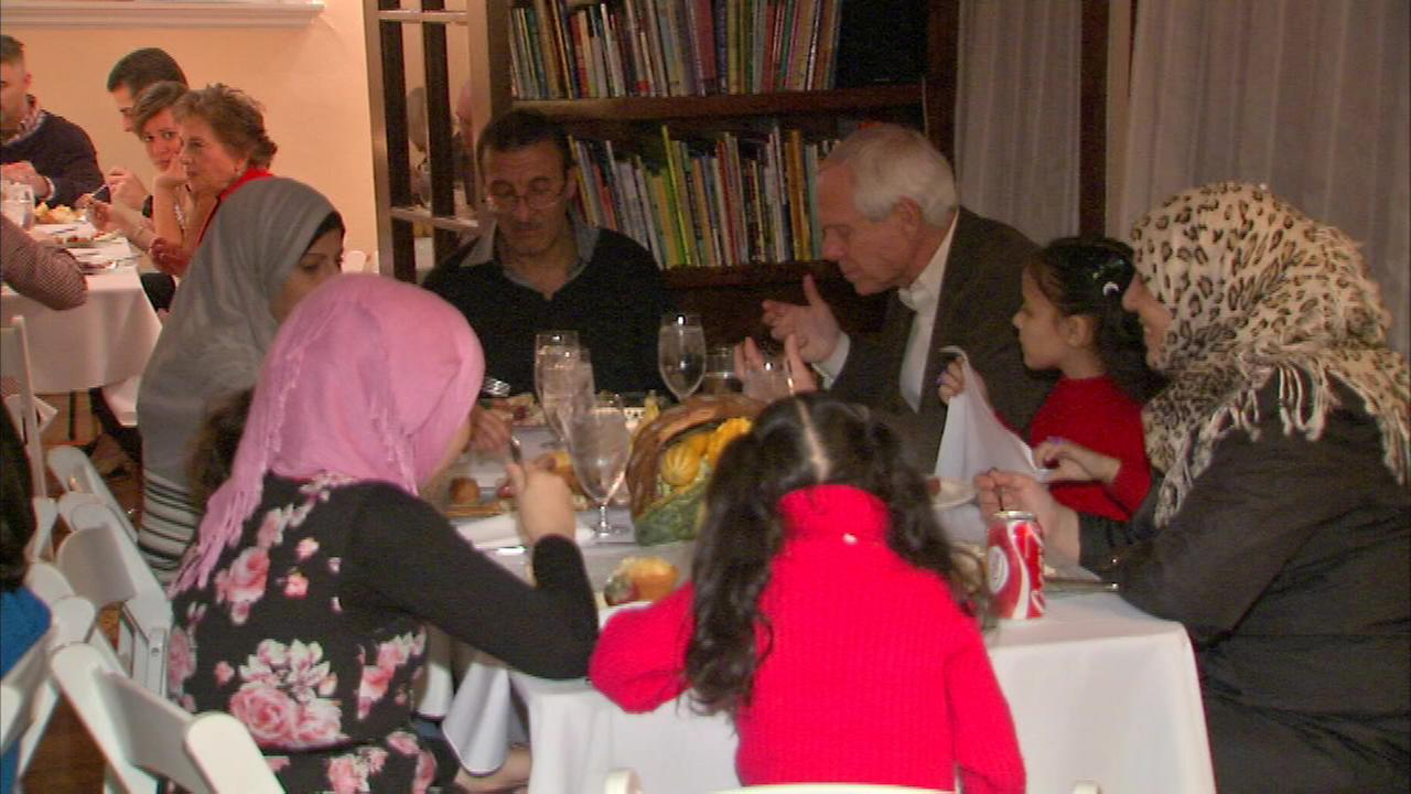 Two Syrian refugee families were welcomed Friday night at a Thanksgiving dinner in Evanston.