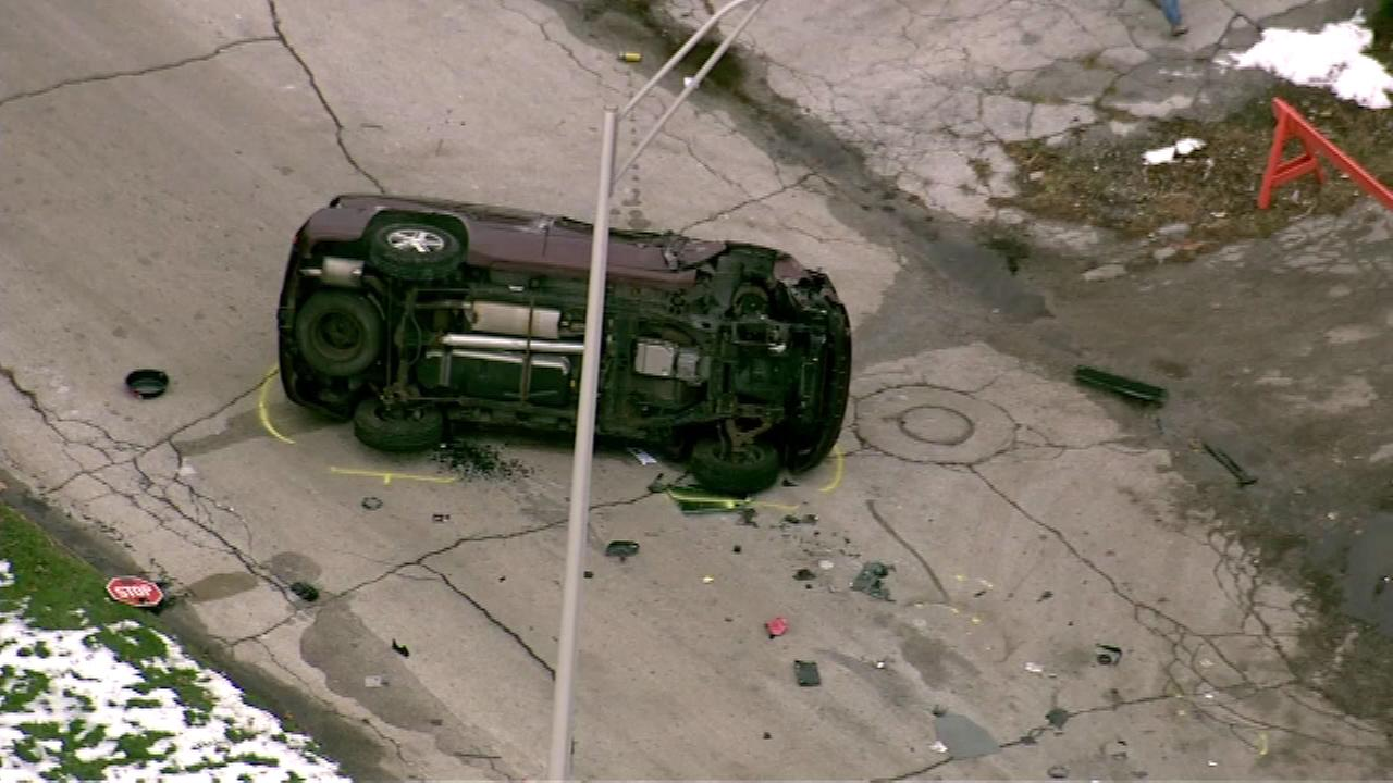 Police said the SUV hit two girls, then crashed into parked cars.