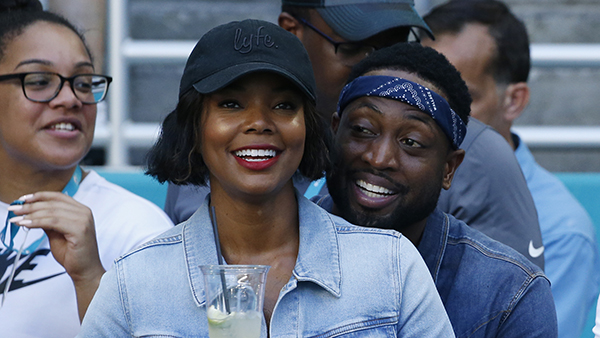 Miami Heat player Dwyane Wade and his wife Gabrielle Union acknowledge the cheers from the crowd during the Miami Dolphins vs. Chicago Bears game, Sunday, Oct. 14, 2018.
