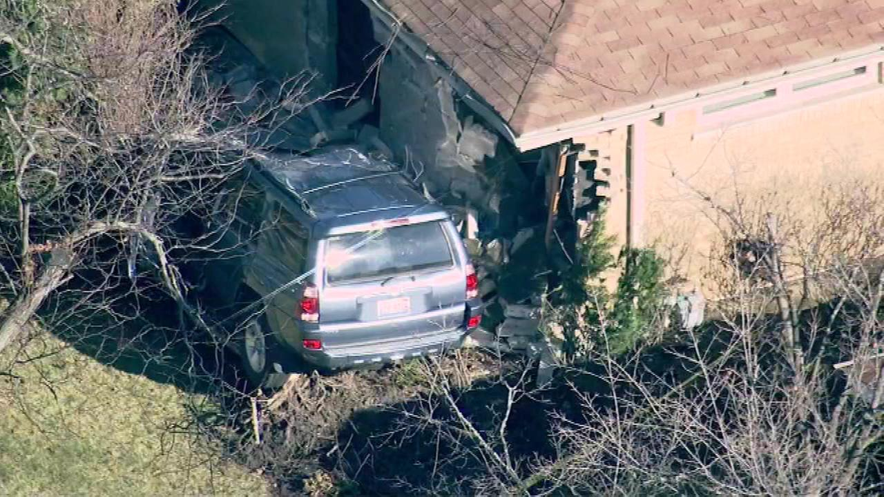 An SUV struck a home in Elmhurst just before 12 p.m. on Friday, December 4, 2015.