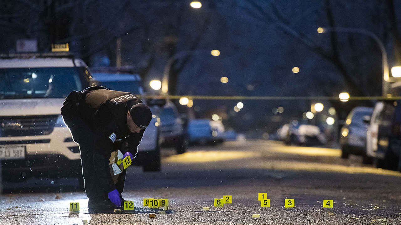 Police investigate the scene where three people were wounded whiled traveling in a vehicle, Sunday morning in the 6500-block of South Hoyne in the Englewood neighborhood.